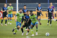 SAN JOSE, CA - OCTOBER 18: Chris Wondolowski #8 of the San Jose Earthquakes battles for the ball with Yeimar Gomez Andrade #28 of the Seattle Sounders during a game between Seattle Sounders FC and San Jose Earthquakes at Earthquakes Stadium on October 18, 2020 in San Jose, California.