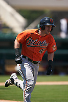 Baltimore Orioles Doran Turchin (49) runs to first base during a Minor League Spring Training game against the Detroit Tigers on April 14, 2021 at Joker Marchant Stadium in Lakeland, Florida.  (Mike Janes/Four Seam Images)