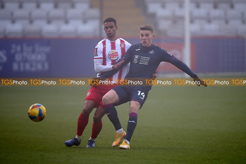 Terence Vancooten of Stevenage and Viktor Gyokeres of Swansea City during Stevenage vs Swansea City, Emirates FA Cup Football at the Lamex Stadium on 9th January 2021