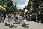 Children dancing around a May Pole Petersham village fete Richmond Surrey UK. 2010s 2011 UK