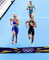04 AUG 2012 - LONDON, GBR - Lisa Norden (SWE) of Sweden (left) and Nicola Spirig (SUI) of Switzerland (right), with Erin Densham (AUS) of Australia (top) chasing, sprint for the line at the end of the women's London 2012 Olympic Games Triathlon in Hyde Park in London, Great Britain (PHOTO (C) 2012 NIGEL FARROW)
