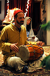 Pujari Premanand drums as others sing during evening Aarati at the Haidakhandi Universal Ashram near Crestone, CO. Michael Brands for The New York Times.