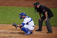 Los Angeles Dodgers catcher Yasmani Grandal and umpire Tim Welke await the pitch during the MLB All-Star Game on July 14, 2015 at Great American Ball Park in Cincinnati, Ohio.  (Mike Janes/Four Seam Images)