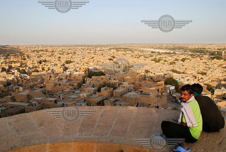 Two men look out over the city from Jaisalmer fort.