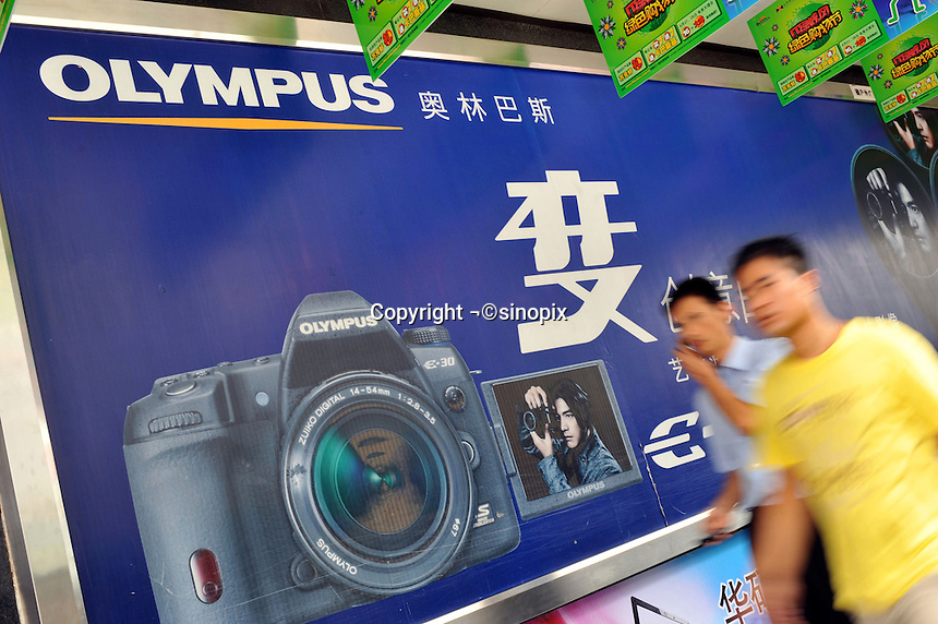 An Olympus advertisement in Guangzhou, China. The financial crisis won't have too much impact on Chinese consuming market. According to a survey by Nielsen of 50 countries and regions, only 35 percent of Chinese people believed the domestic economy was in a contraction. The figure was the lowest among the 50 world markets..