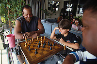 LOS ANGELES, CA - Former Cleveland Browns great Jim Brown plays chess in his home in Los Angeles, California in 1991. Photo by Brad Mangin