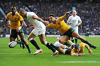 Mike Brown of England attempts to clear the line as Nick Phipps of Australia tries to block him during the Old Mutual Wealth Series match between England and Australia at Twickenham Stadium on Saturday 3rd December 2016 (Photo by Rob Munro)
