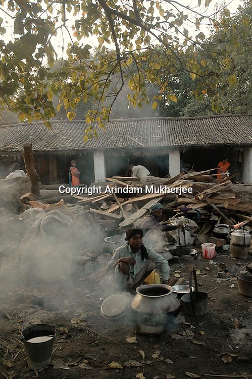 Pilgrims cook their food in the open at Sonepur fair ground. Bihar, India, Arindam Mukherjee