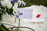 © Joel Goodman - 07973 332324 . 17/03/2012 . Staffordshire , UK . Flowers and tributes left at the graveside . The funeral of former police officer David Rathband , at Stafford Crematorium . Rathband was found dead at his home in Blyth on 29th February 2012 . He was shot and blinded by killer Raoul Moat whilst he was on duty in the early hours of 4th July 2010 and went on to campaign for the Blue Lamp Foundation , which supports emergency staff injured in the line of duty , but he was reported to have never overcome the psychological impact of his injuries . Photo credit : Joel Goodman