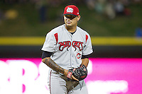 Carolina Mudcats relief pitcher Elvis Araujo (23) looks to his catcher for the sign against the Winston-Salem Dash at BB&T Ballpark on June 6, 2014 in Winston-Salem, North Carolina.  The Mudcats defeated the Dash 3-1.  (Brian Westerholt/Four Seam Images)