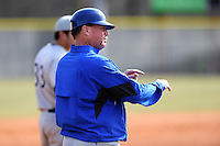 Head coach Tim Wallace of the Spartanburg Methodist College Pioneers gives signals in a junior college game against Lenoir Community College on February 2, 2014, at Mooneyham Field in Spartanburg, South Carolina. SMC won 23-8. (Tom Priddy/Four Seam Images)
