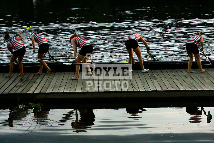 Rowers from Florida Tech prepare to take their boat from the water following a third place finish in the Women's Varsity Heavyweight Eight Division II &III Final during the 68th Dad Vail Regatta on the Schuylkill River in Philadelphia, Pennsylvania on May 13, 2006...............................