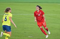 YOKOHAMA, JAPAN - AUGUST 6: Jessie Fleming #17 of Canada celebrates scoring a PK during a game between Canada and Sweden at International Stadium Yokohama on August 6, 2021 in Yokohama, Japan.