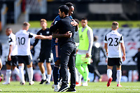 12th September 2020; Craven Cottage, London, England; English Premier League Football, Fulham versus Arsenal; Arsenal Manager Mikel Arteta embraces goal scorer Gabriel
