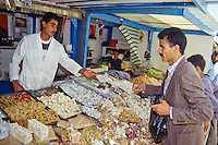 Tunisia, Sidi Bou Said.  Candy Vendor, Selling Turkish Delight and other Sweets.