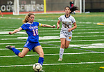WOODBURY, CT-111120JS12 —Nonnewaug's Kate Greene (10) takes a shot on goal as Wolcott Tech'sAdriana Thompson (24) looks on during their game Wednesday at Nonnewaug High School. <br /> Jim Shannon Republican-American