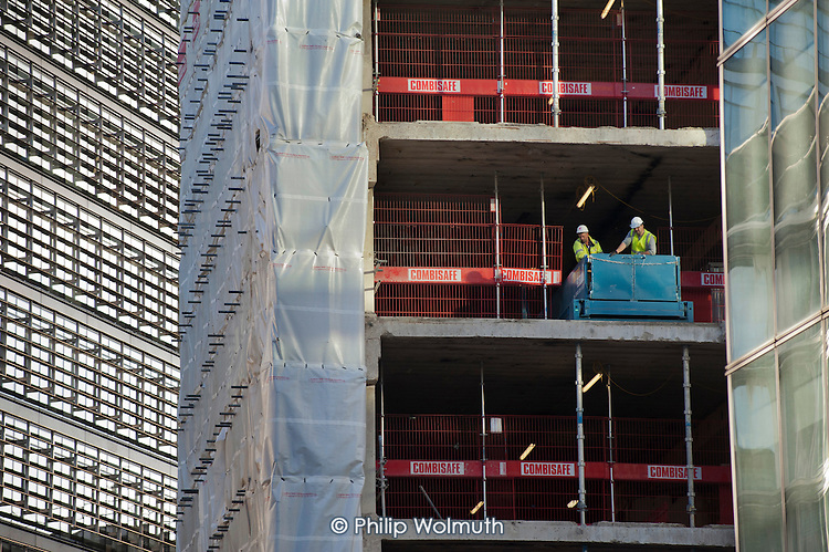 Construction workers on a high rise office development in the City of London.