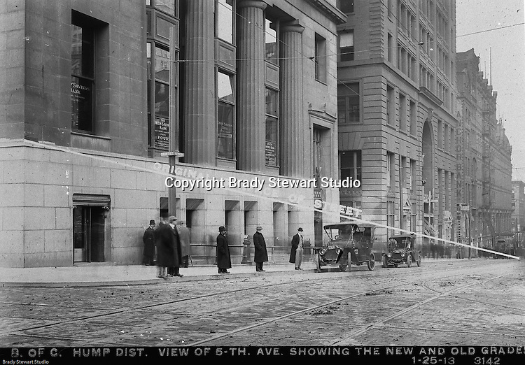 Pittsburgh PA: View of an old lantern slide created by Brady Stewart for the Pittsburgh Citizens Committee on City Plan (CCCP) when they were crafting the City Plan.  <br /> This view highlights the dramatic change to Fifth Avenue after the hump was removed from Grant Street.<br /> Most of the buildings on Grant and neighboring streets needed renovation due to the construction.<br /> The negative and print were ordered by the Pittsburgh Regional Planning Association for a meeting in 1968.