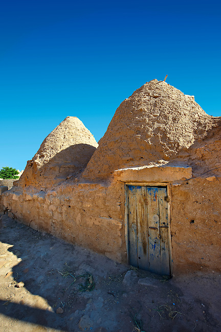 """Pictures of the beehive adobe buildings of Harran, south west Anatolia, Turkey.  Harran was a major ancient city in Upper Mesopotamia whose site is near the modern village of Altınbaşak, Turkey, 24 miles (44 kilometers) southeast of Şanlıurfa. The location is in a district of Şanlıurfa Province that is also named """"Harran"""". Harran is famous for its traditional 'beehive' adobe houses, constructed entirely without wood. The design of these makes them cool inside. 45"""