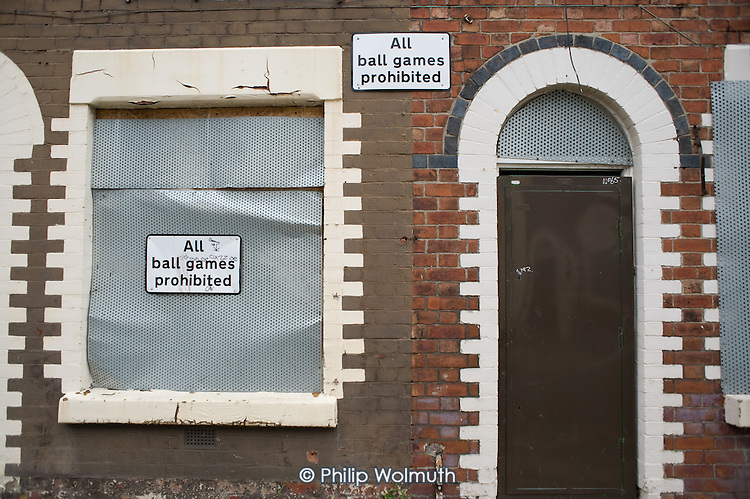 'All ball games prohibited': houses in Anfield, around Liverpool football stadium, scheduled for demolition by the Merseyside NewHeartlands partnership, financed by the Housing Market Renewal Fund, part of a government strategy aimed at tackling 'low demand'.  Some long-standing residents oppose the demolition of their homes.