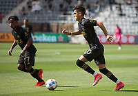 LOS ANGELES, CA - APRIL 17: Eduard Atuesta #20 of LAFC moves with the ball during a game between Austin FC and Los Angeles FC at Banc of California Stadium on April 17, 2021 in Los Angeles, California.