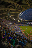 29 March 2014: A crowd of 50,229 fill the seats of Olympic Stadium for a pre-season exhibition game between the Toronto Blue Jays and the New York Mets in Montreal, Quebec. The Blue Jays shut out the Mets 2-0 in the first MLB professional baseball series since September of 2004. Members of the 1994 Expos were honored in a pre-game ceremony as the Blue Jays swept the 2-game series. Mandatory Credit: Ed Wolfstein Photo *** RAW (NEF) Image File Available ***