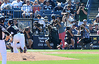 New York Yankees pitcher Masahiro Tanaka (19) delivers a warmup pitch as the media takes images during a spring training game against the Philadelphia Phillies on March 1, 2014 at Steinbrenner Field in Tampa, Florida.  Tanaka signed for the 155 million dollars after he went 24-0 with a 1.27 ERA for the Rakuten Golden Eagles in Japan during the 2013 season;  New York defeated Philadelphia 4-0.  (Mike Janes/Four Seam Images)