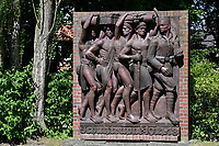 GERMANY, Hamburg, controversial colonial German East-Africa monument, Askari wall relief at former Nazi Lettow-Vorbeck barracks in Jenfeld , Askari is a term for the native african soldiers serving in the colonial troops, display of Askari soldier of the german troop followed by african load carriers , monument designed and established 1938 / DEUTSCHLAND, Hamburg, Germany, Hamburg, Deutsch-Ostafrika-Ehrenmal, Askari Relief im sogenannten Tansania Park auf dem Gelaende der ehemaligen Wehrmacht Kaserne Lettow-Vorbeck in Jenfeld, Askari abgeleitet vom Swahili Wort Soldat, Bezeichnung für die einheimischen Soldaten oder Polizisten in den Kolonialtruppen, Darstellung eines Askari Soldaten der deutschen Schutztruppe gefolgt von afrikanischen Lastenträgern, geschaffen und aufgestellt 1938 von Bildhauer Walter von Ruckteschell