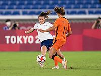 YOKOHAMA, JAPAN - JULY 30: Kelley O'Hara #5 of the USWNT tackles Lieke Martens #11 of the Netherlands during a game between Netherlands and USWNT at International Stadium Yokohama on July 30, 2021 in Yokohama, Japan.