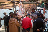 Morocco.  A Butcher at Work in the Market.  Had Draa Market, Essaouira Province.