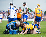 Tony Kelly of Clare recovers after being floored by Kevin Moran of Waterford during their Munster  championship round robin game at Cusack Park Photograph by John Kelly.