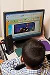 Education Preschool 4 year olds boy using computer in classroom