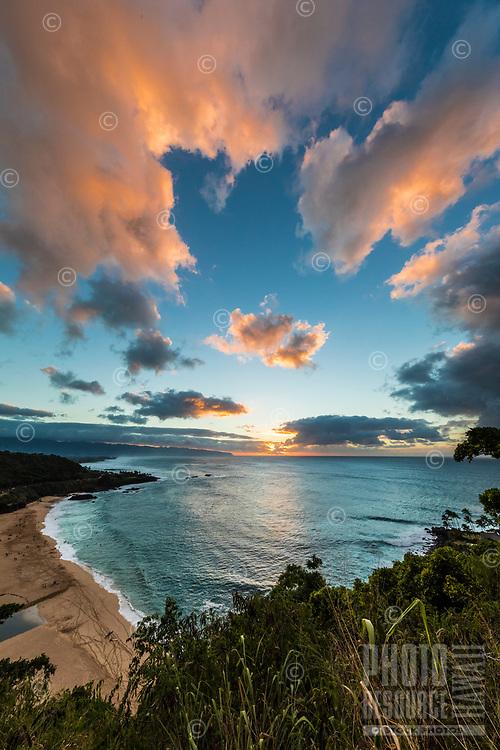 Waimea Bay on the North Shore of O'ahu at sunset.