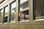 Essex, CT Steam Train excursion. Young boy looking train car window.