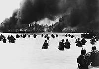 165th Inf. assault wave attacking Butaritari, Yellow Beach Two, find it slow going in the coral bottom waters.  Jap machine gun fire from the right flank makes it more difficult for them.  Makin Atoll, Gilbert Islands, November 20, 1943.  Dargis. (Army)<br /> NARA FILE #:  111-SC-183574<br /> WAR & CONFLICT BOOK #:  1167