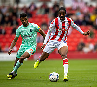 11th September 2021;  Bet365 Stadium, Stoke, Staffordshire, England; EFL Championship football, Stoke City versus Huddersfield Town; Romaine Sawyers of Stoke City under pressure from  Fraizer Campbell of Huddersfield Town