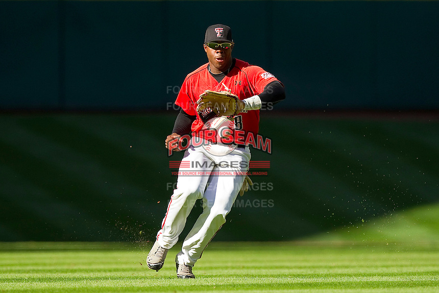 Center fielder Barrett Barnes #8 of the Texas Tech Red Raiders charges a base hit during the game against the Houston Cougars at Minute Maid Park on March 4, 2012 in Houston, Texas.  The Red Raiders defeated the Cougars 10-4.  Brian Westerholt / Four Seam Images