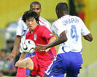 Goal scorer Ji Sung Park (7) of Korea battles Patrick Vieira (4) o France for the ball. The Korea Republic and France played to a 1-1 tie in their FIFA World Cup Group G match at the Zentralstadion, Leipzig, Germany, June 18, 2006.