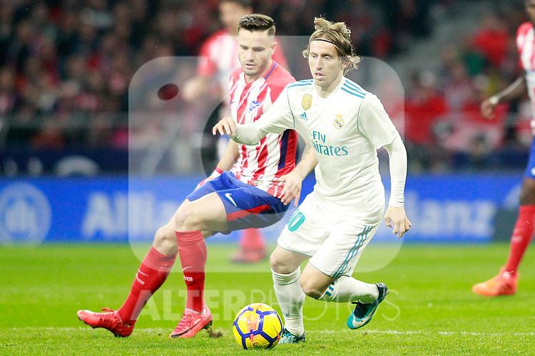Atletico de Madrid's Saul Niguez (l) and Real Madrid CF's Luka Modric during La Liga match. November 18,2017. (ALTERPHOTOS/Acero)