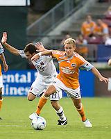 Houston Dynamo midfielder Stuart Holden (22) dribbles around D.C. United midfielder Ben Olsen (14).  Houston Dynamo defeated D.C. United 4-3 at Robertson Stadium in Houston, TX on August 1, 2009.