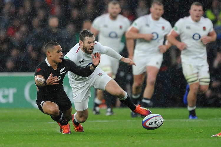 Elliot Daly of England and Aaron Smith of New Zealand compete for a loose ball during the Quilter International match between England and New Zealand at Twickenham Stadium on Saturday 10th November 2018 (Photo by Rob Munro/Stewart Communications)