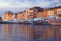 harbor, St. Tropez, France, Cote d' Azur, Provence, Var, Europe, Yachts docked in the harbor of Saint Tropez at sunset on the Mediterranean Sea.