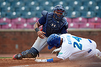 Rome Braves catcher Carlos Martinez (19) tags Marten Gasparini (24) on a play at home plate during a game against the Lexington Legends on May 23, 2018 at Whitaker Bank Ballpark in Lexington, Kentucky.  Rome defeated Lexington 4-1.  (Mike Janes/Four Seam Images)