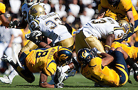 C.J. Moncrease (8) and Sean Cattouse (11) combine on Derrick Coleman (33) and Josh Smith (3). The California Golden Bears defeated the UCLA Bruins 35-7 at Memorial Stadium in Berkeley, California on October 9th, 2010.