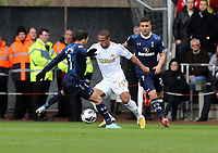 Pictured: Wayne Routledge of Swansea (C) avoids Aaron Lennon (L) and another Tottenham player. Saturday 30 March 2013<br /> Re: Barclay's Premier League, Swansea City FC v Tottenham Hotspur at the Liberty Stadium, south Wales.