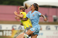Sky Blue forward, Natasha Kai (6), shoulders Philadelphia defender, Allison Falk (3), aside as they battle for the ball.  After a nearly two hour rain delay, Sky Blue FC defeated the Philadelphia Independence on a second half goal by Yael Averbuch in a game played at Yurcak Field on the Rutgers University Campus in Piscataway, NJ.