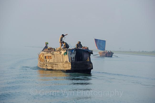 Boat hauling firewood from the interior of Myanmar to Sittwe. Rakhine State, Myanmar.