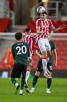 23rd December 2020; Bet365 Stadium, Stoke, Staffordshire, England; English Football League Cup Football, Carabao Cup, Stoke City versus Tottenham Hotspur; Danny Batth of Stoke City heads the ball in front of Dele Alli of Tottenham Hotspur