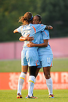 Rosana (11) of Sky Blue FC celebrates scoring with Natasha Kai (6). The Philadelphia Independence defeated Sky Blue FC 4-1 during a Women's Professional Soccer (WPS) match at Yurcak Field in Piscataway, NJ, on June 19, 2010.