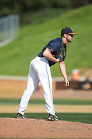 Virginia Cavaliers relief pitcher Bennett Sousa (11) looks to his catcher for the sign against the Wake Forest Demon Deacons at David F. Couch Ballpark on May 19, 2018 in  Winston-Salem, North Carolina. The Demon Deacons defeated the Cavaliers 18-12. (Brian Westerholt/Four Seam Images)